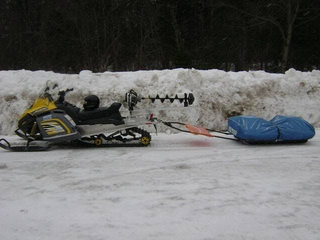 Snowmobile auger rack for Ice fishing snowmobile